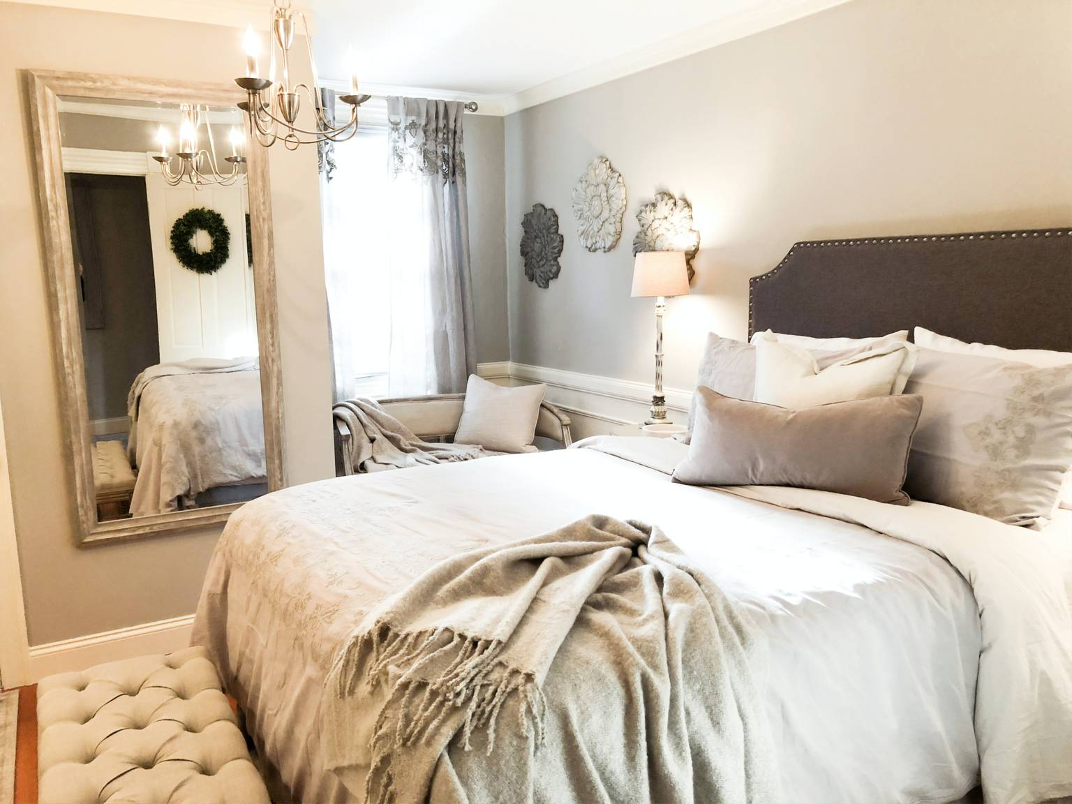 A large white bed in a hotel room at The Watson Boutique Bed & Breakfast.