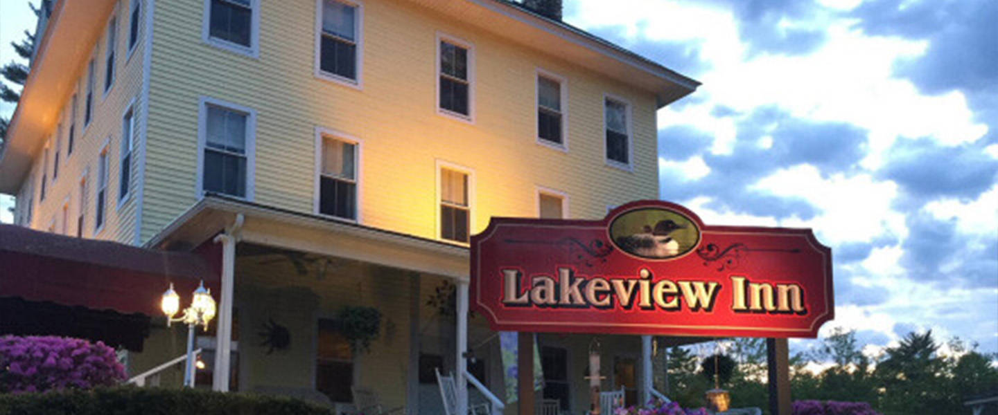 A sign in front of a building at Lakeview Inn.