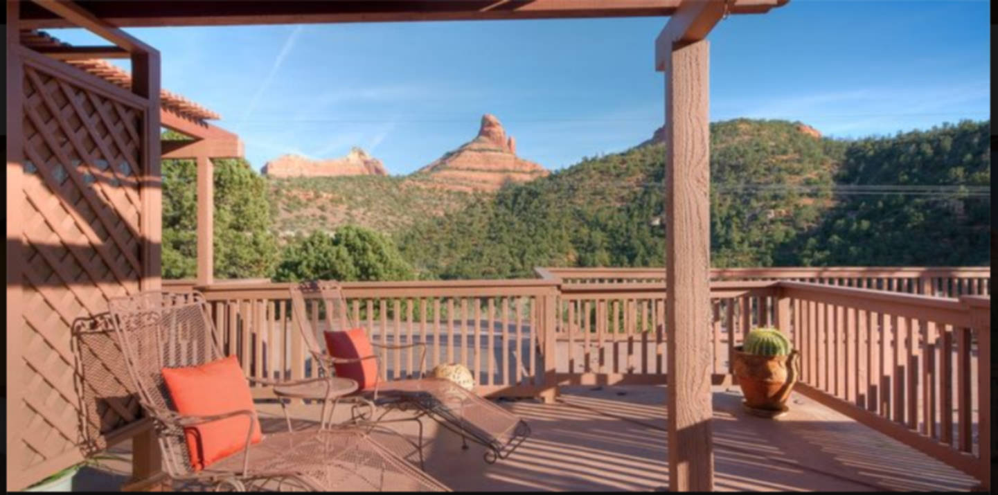 A building with a wooden fence at Sedona Views Bed and Breakfast.
