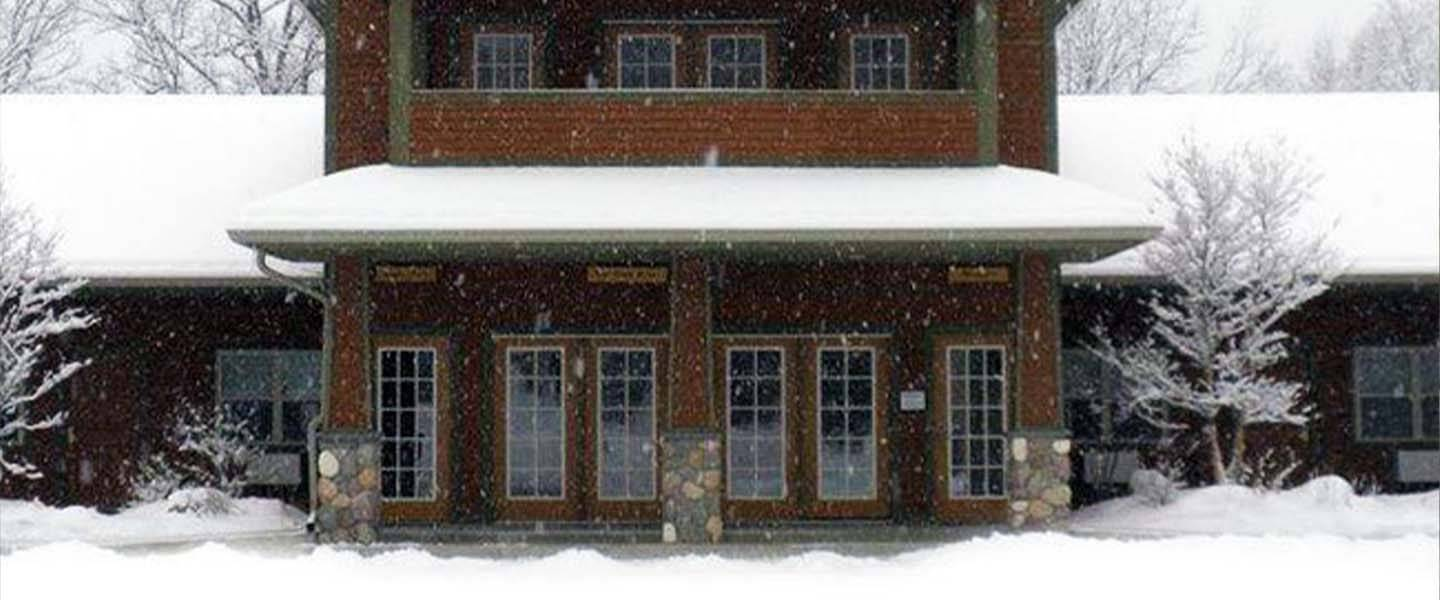 A house covered in snow at The Alpine Lodge.