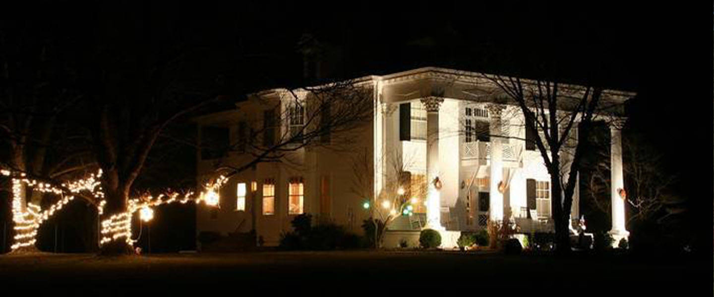 A building lit up at night at Winridge Manor.