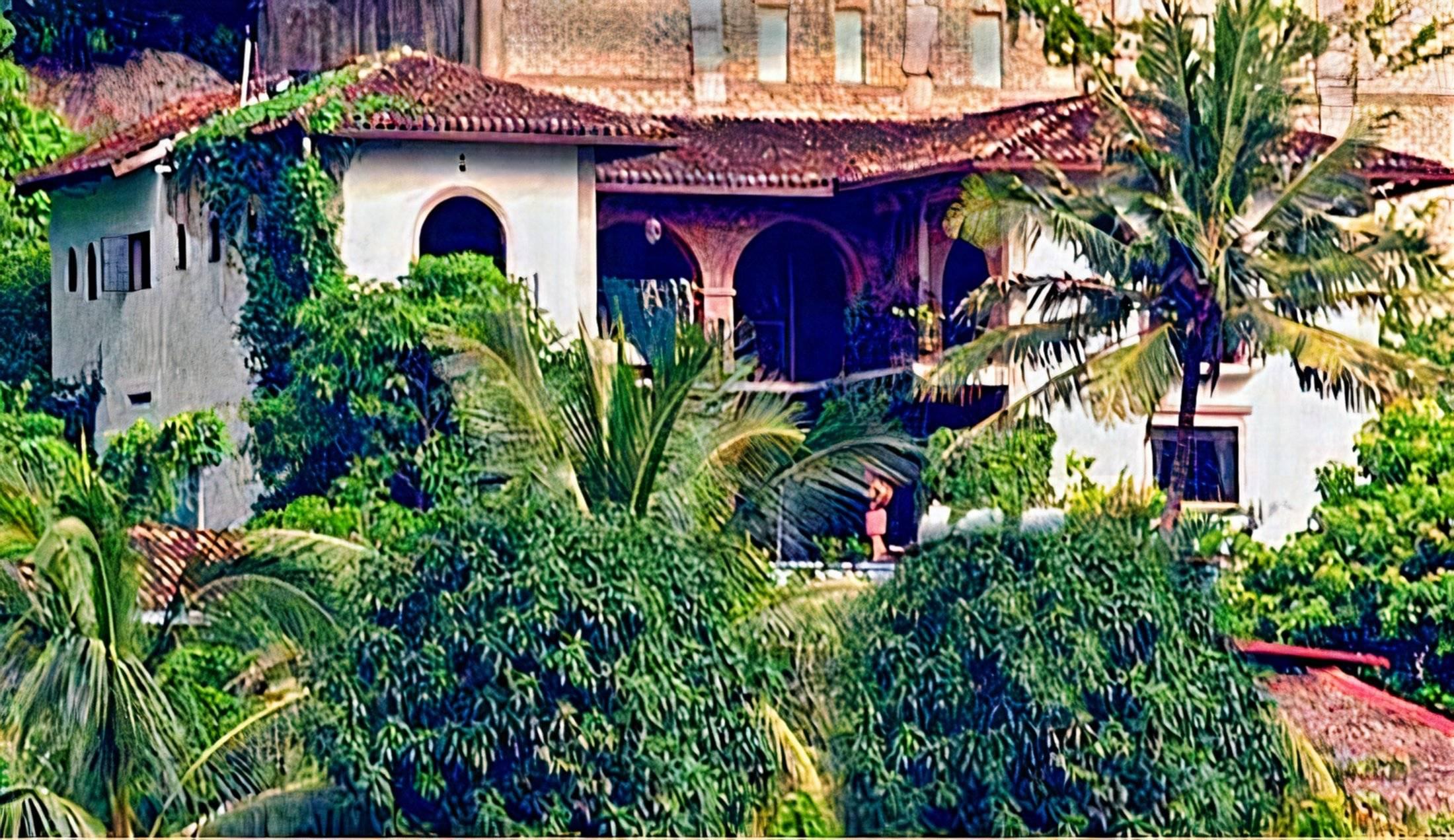 A garden in front of a building at Hacienda Las Animas in Puerto Vallarta.