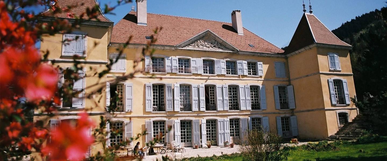 A large brick building with many windows at Château de Bardonenche.
