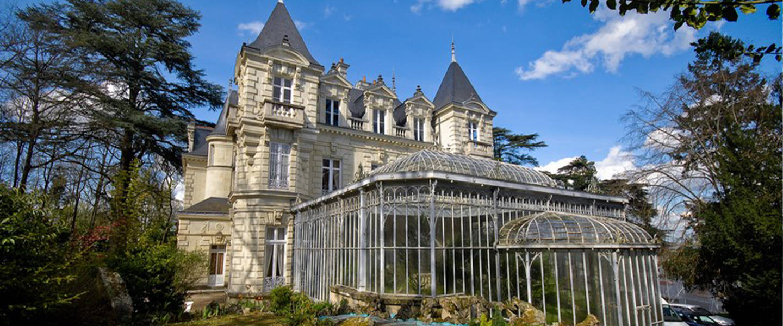 A large stone building at Chateau Bouvet Ladubay.
