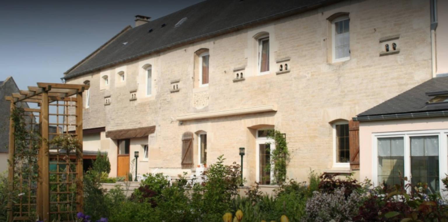 A large brick building at Le Clos de la Barre.