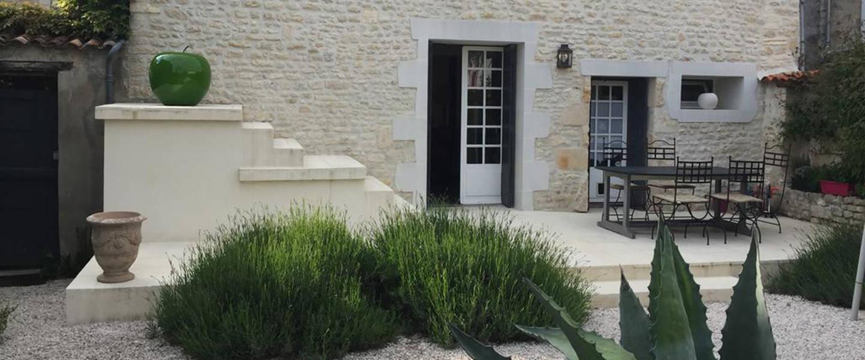 A large white building at La maison du Baloir.