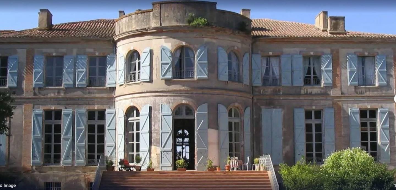 A large brick building at Chateau de Clermont-Saves.