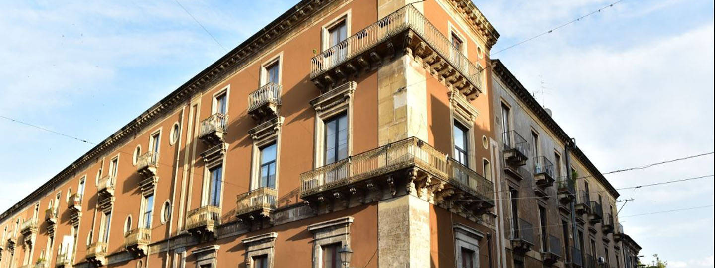A tall building in a city at B&B Palazzo Bruca Catania.