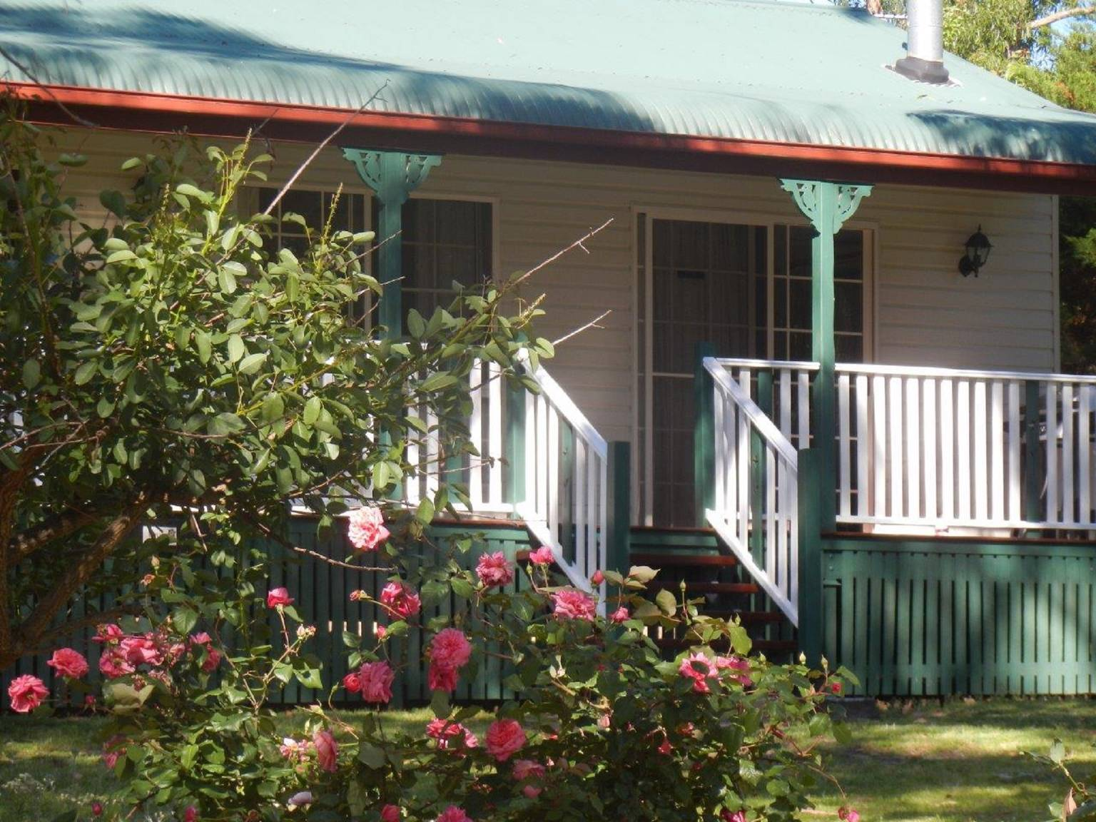 A close up of a flower garden in front of a building at Cairns B & B.