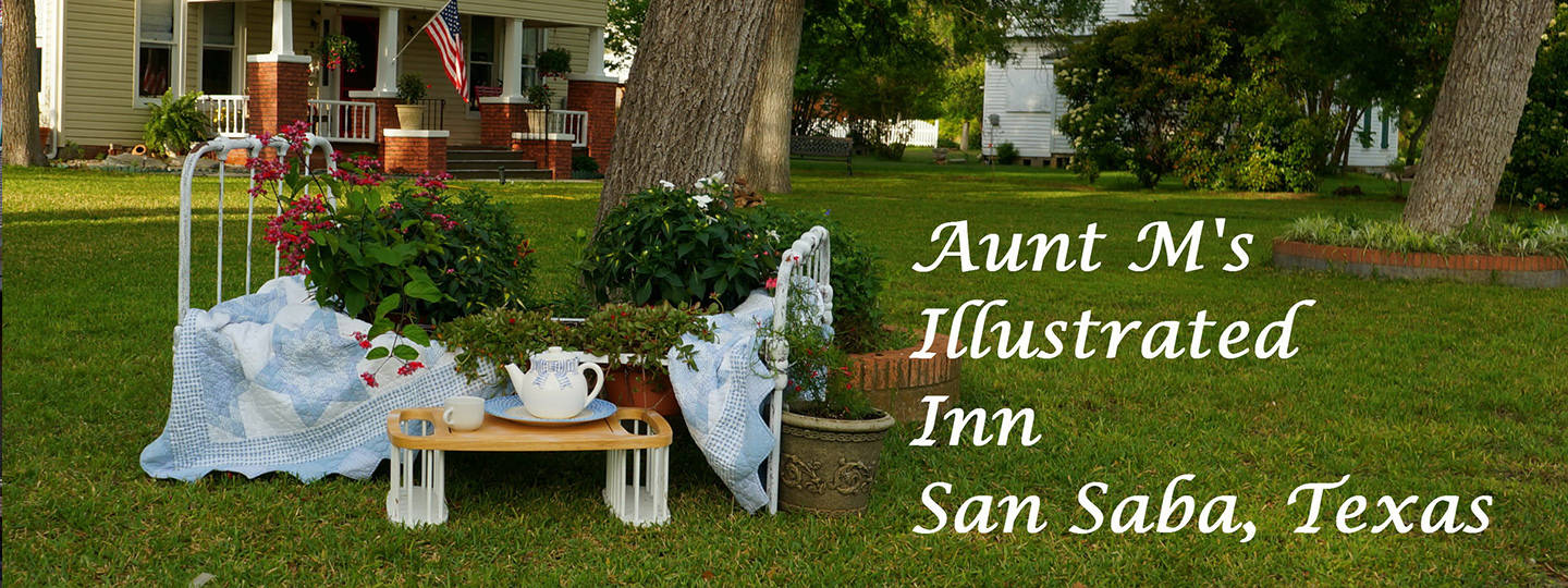A couple of lawn chairs sitting on top of a grass covered field at Aunt M's Illustrated Inn.
