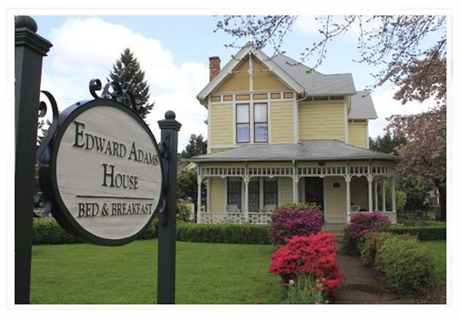 A sign in front of a house at Edward Adams House B&B.
