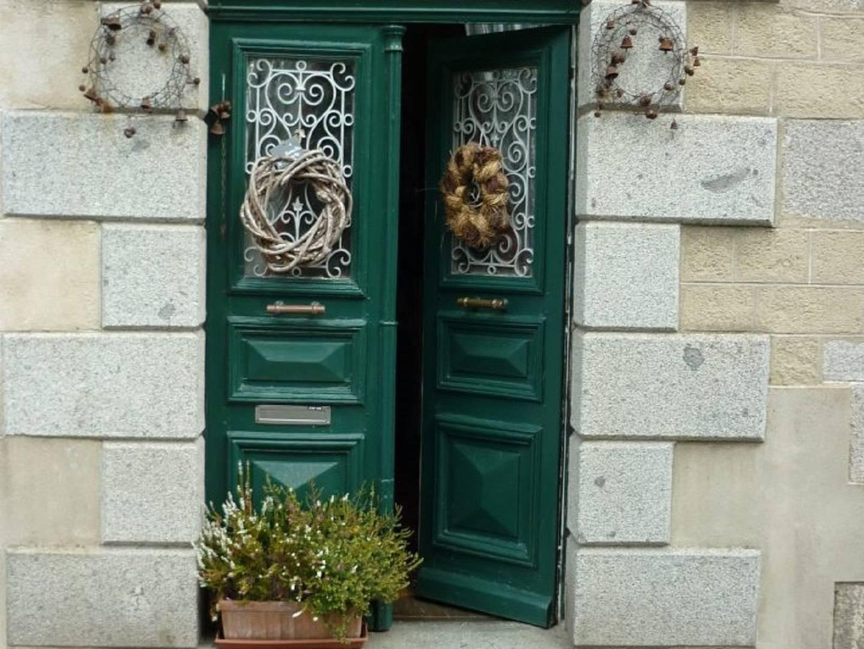 A building with a green door at La Maison de Claire.