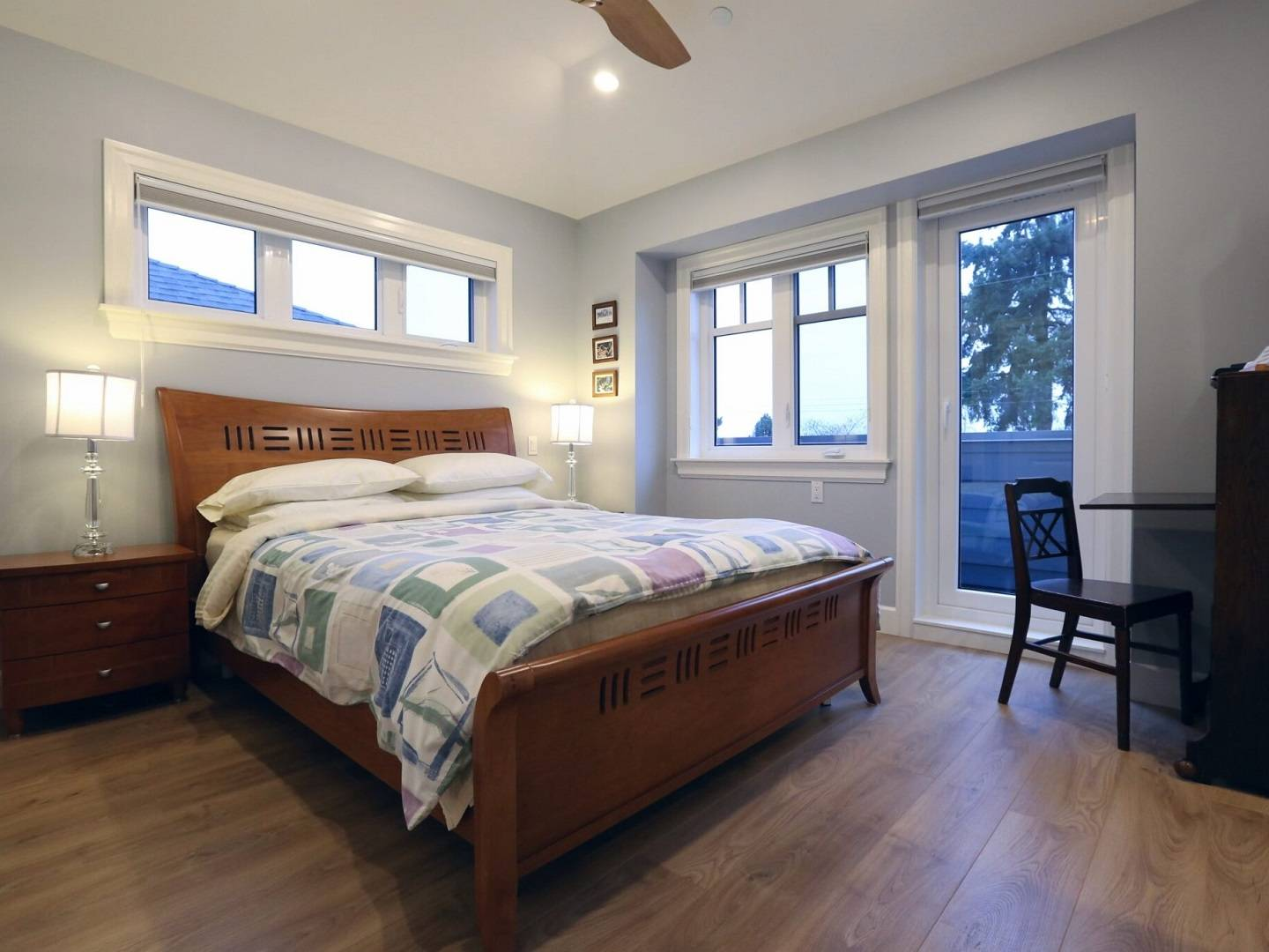 A bedroom with a bed and a window at A Vancouver Traveller Bed and Breakfast.
