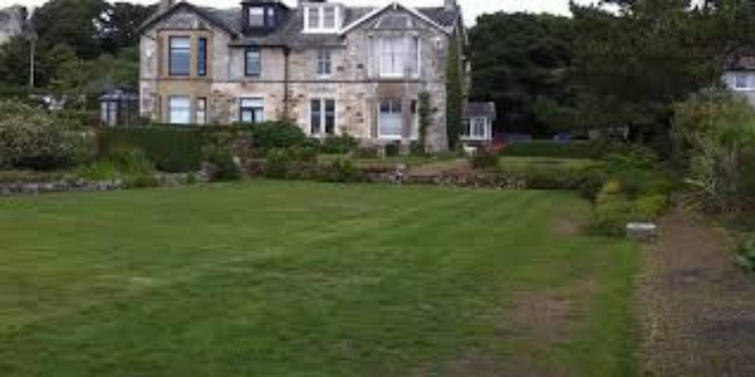 A castle on top of a lush green field at Carlton Seamill Bed & Breakfast.