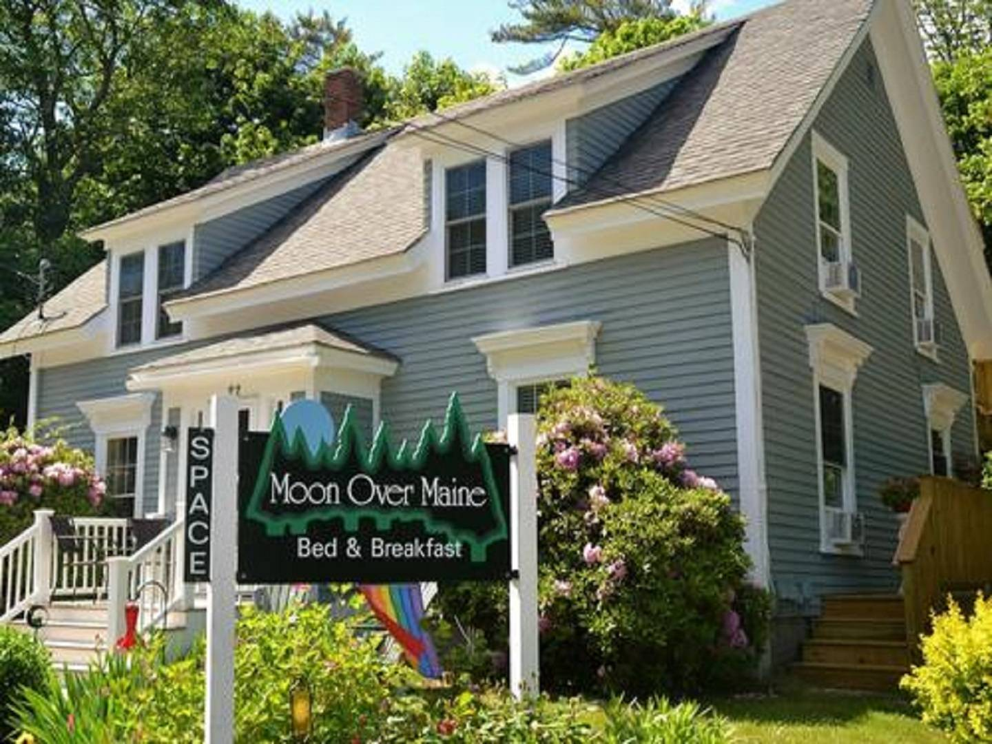 A sign in front of a house at Moon Over Maine.