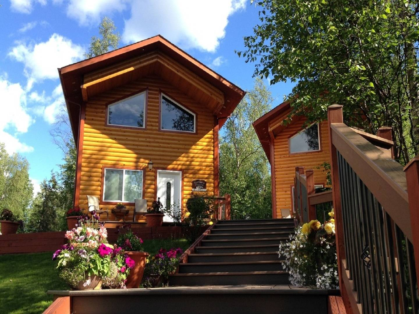 A house with bushes in front of a building at Alaska Adventure Unlimited Chalets.